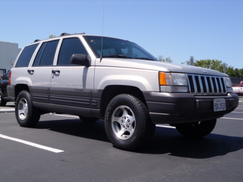 find a cheap used 1997 jeep grand cherokee 4x4 in orange. Black Bedroom Furniture Sets. Home Design Ideas